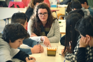 Student Maeve Brockie from Liverpool, a future teacher, working with young students, former refugees, at a grammar school.